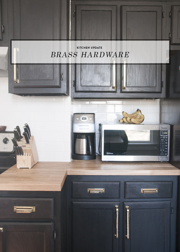 brass hardware black cabinets